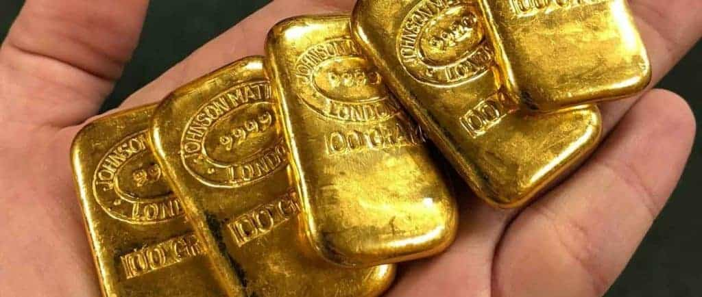 Gold Bars in Hand